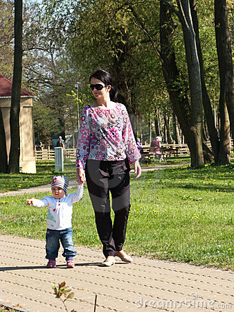 Mother walking baby daughter