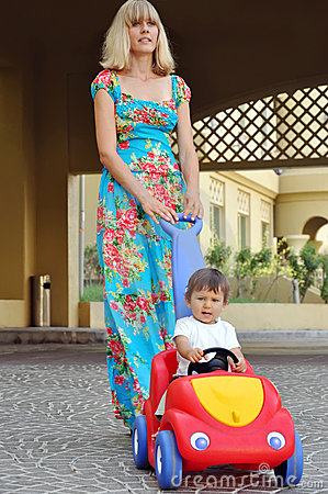 Mother walking with her little son