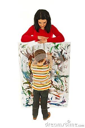 Mother watch her painter boy