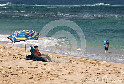 mother watching child at the beach