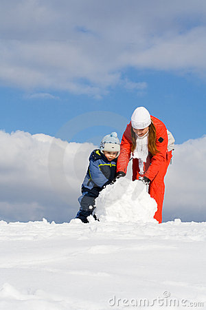 Free Mother With Kid Making Snowman Stock Photo - 6311950