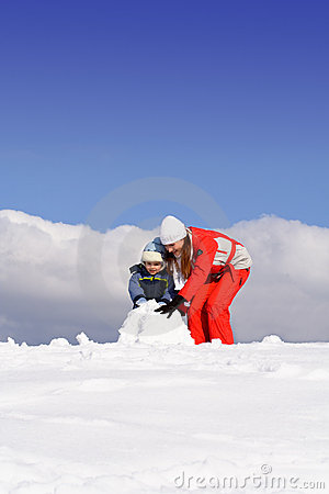 Free Mother With Kid Making Snowman Stock Photography - 6813662