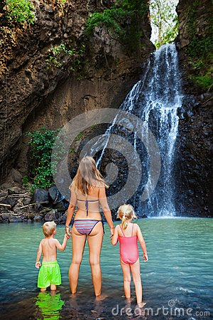 Free Mother With Kids Swim In Water Pool Under Waterfall Stock Photo - 103793620