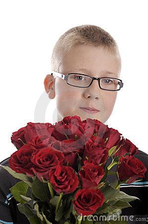 Mothers day: boy with bouquet of red roses