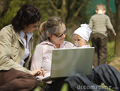 Mothers are using a laptop