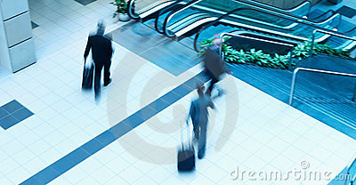 Motion blur business people walking in mall