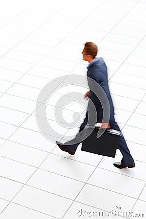 Motion Blur - businessman  walking with briefcase