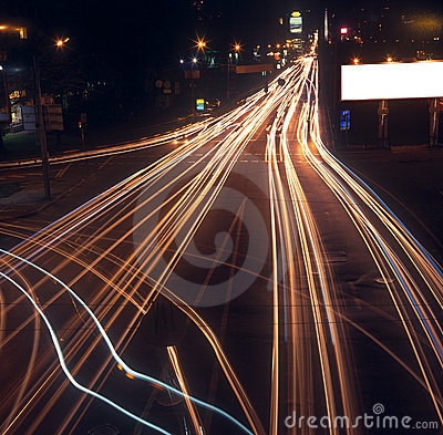 Motion blur of car lights on street at night.