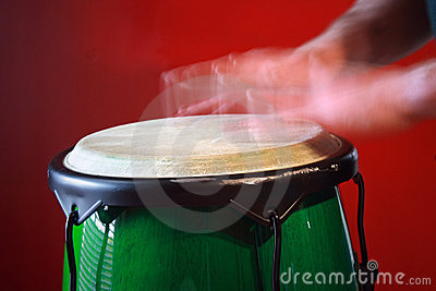 Motion blur of hands on drum