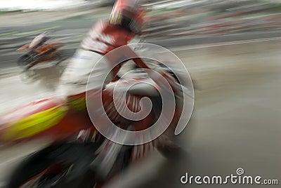 Motion blur of motorbike racer.