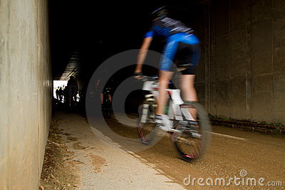 Motion blur of MTB rider entering tunnel Editorial Image