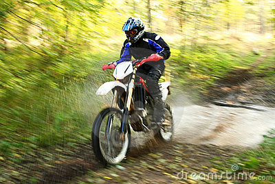 Motion blur, offroad motorbike crossing river
