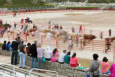 Motion Blur Of People Running With Bulls As Spectators Watch Editorial Stock Photo
