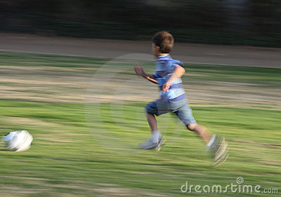 Motion blurred photo of boy running