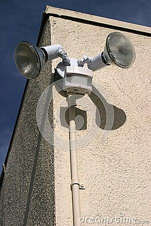 Motion sensor lights on the side of a building
