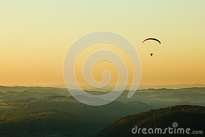 Moto paraglider above the landscape