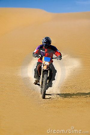 Moto racer in desert