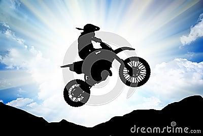 Moto racer in sunny sky.