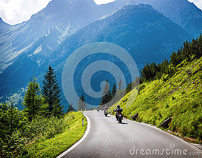 Moto racers on mountainous road