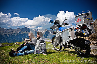 Moto travellers with motocycle in Switzerland Alps Editorial Stock Photo