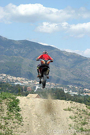Free Moto X Motorbike Jumping Through The Air On A Hot Sunny Day With Big Blue Sky Stock Image - 124701