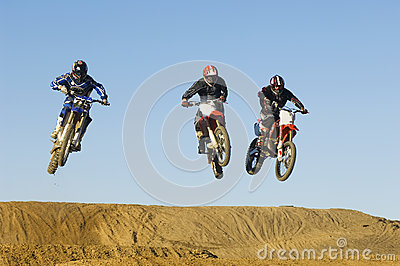 Motocross Male Racers Racing Against Sky