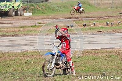 Motocross racer greets spectators Editorial Image