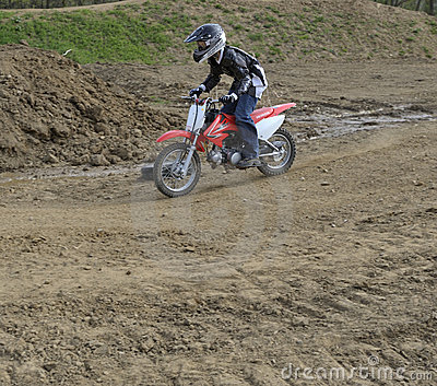 Motocross Racer Riding on a Dirt Track Editorial Image