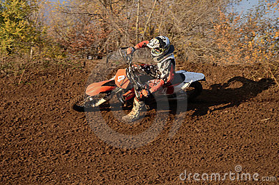 Motocross racer turns with large slope Editorial Stock Photo
