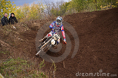 Motocross racer turns with large slope Editorial Photography
