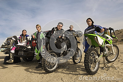 Motocross Racers With Motorcycles And Pickup Truck In Desert