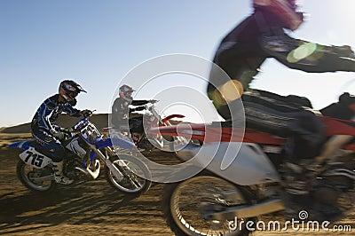 Motocross Racers Racing In Desert