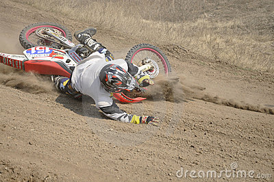 Motocross rider crash, dusty track Editorial Stock Image