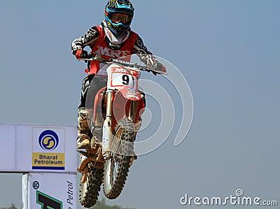 Motocross rider Veer Patel jumping the tabletop Editorial Stock Photo