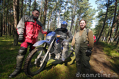 Motocross riders in forest