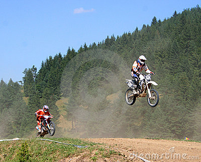 Motocross riders on track Editorial Image