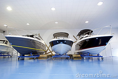 Motor boats in showroom or garage