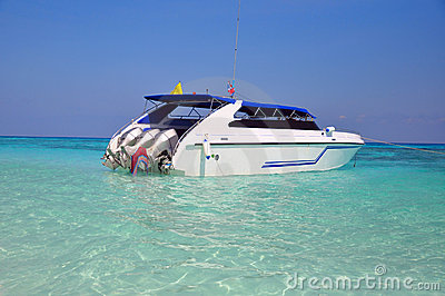Motor boats on turquoise water of Indian Ocean