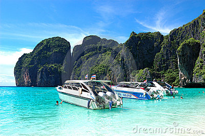 Motor boats on turquoise water of Maya Bay lagoon Editorial Stock Photo