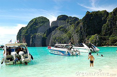 Motor boats on turquoise water of Maya Bay lagoon Editorial Stock Image
