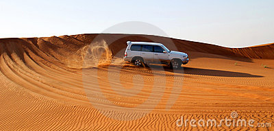Motor car in desert