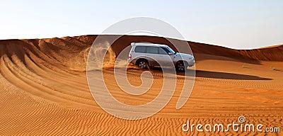 Motor car in desert