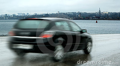Motor car traveling at speed