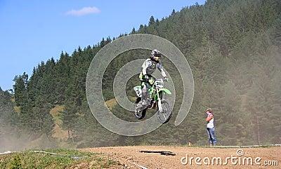 Motor cross rider in midair Editorial Photography