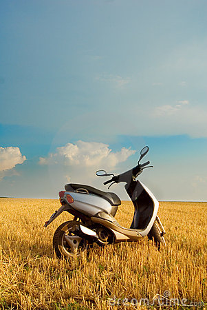 Free Motor Scooter In Field Of Wheat Royalty Free Stock Photo - 3180215