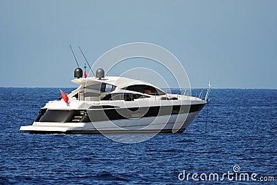 Motor yacht anchored in a calm bay