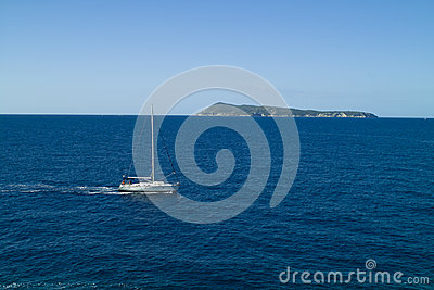 Motor yacht passing by the island