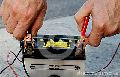Motorbike battery with charging cable