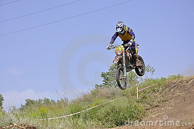 Motorbike racer flying down the mountain Editorial Stock Image