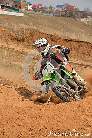 Motorbike racer turns sharply
